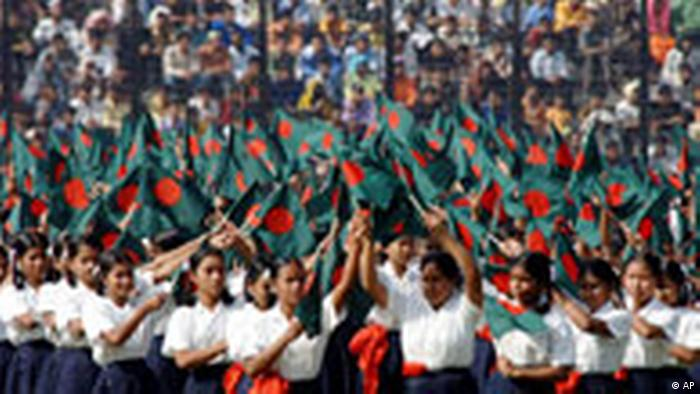 Bangladeshi schoolgirls wave the national flag as they perform during a victory day children's rally in Dhaka, Bangladesh, Friday, Dec.16, 2005. Bangladeshi authorities on Thursday stepped up security across the country in preparation for the 34th anniversary of independence, won in a bloody civil war with Pakistan, officials said. (AP Photo/Zia Islam)