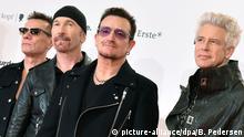 06.12.2015 FILE - Irish band U2 with lead singer Bono (2nd R)arrive on the red carpet before the Bambi Awards at the Stage Theater on Potsdamer Platz inBerlin, Germany, 13 November 2014. Photo: Britta Pedersen/dpa (zu dpa «Nach Anschlag im «Bataclan»: US-Band soll wieder in Paris spielen» vom 06.12.2015) +++(c) dpa - Bildfunk+++   Verwendung weltweit