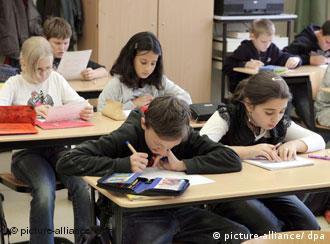 School children working at their classroom desks