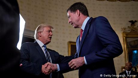 US President Donald Trump and then-FBI Director James Comey shake hands