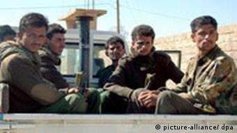 Yemeni soldiers sitting in a truck
