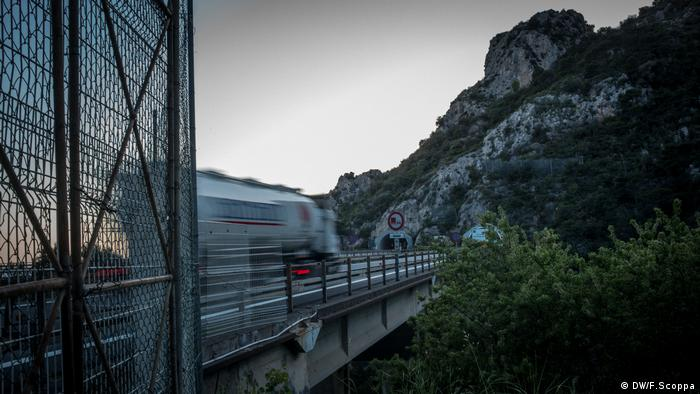 The fence where migrants and refugees access the highway tunnel to France