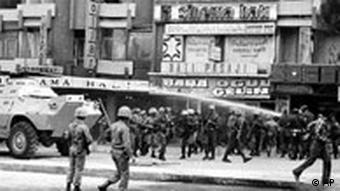 Soldiers disperse demontrators in Ankara streets 300 meters from the parliament few days defore a a coup in Sept. 1980