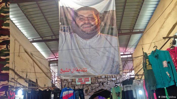 A poster of Allouki hangs from the ceiling of Tripoli's souk