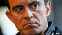 Manuel Valls, former French prime minister and presidential primary candidate, reacts during a campaign visit in Villeurbanne