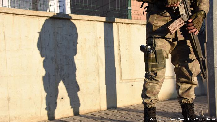Turkish soldier and shadow thrown on wall