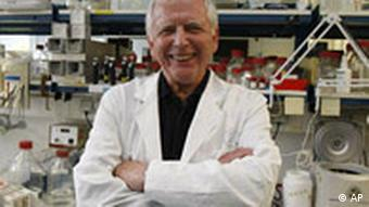 Harald zur Hausen in a laboratory, dressed in a white coat and smiling
