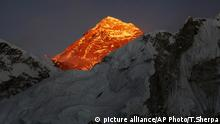 FILE - In this Nov. 12, 2015, file photo, Mt. Everest is seen from the way to Kalapatthar in Nepal. Some climbers attempting to scale Mount Everest during the upcoming spring climbing season will be strapped with a GPS device to locate them in case they are in trouble and to prevent false claims of reaching the summit, officials said Monday. (AP Photo/Tashi Sherpa, File) |