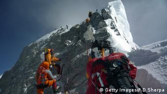 Climbers walking past the Hillary Step near the Mount Everest summit (Photo: STR, AFP, Getty images)
