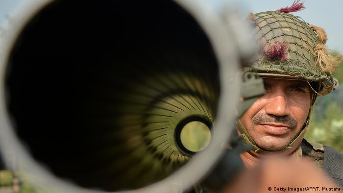 An Indian Border Security Force (BSF) soldier carries a rocket launcher