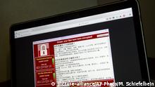 13.05.2017 A screenshot of the warning screen from a purported ransomware attack, as captured by a computer user in Taiwan, is seen on laptop in Beijing, Saturday, May 13, 2017. Dozens of countries were hit with a huge cyberextortion attack Friday that locked up computers and held users' files for ransom at a multitude of hospitals, companies and government agencies. (AP Photo/Mark Schiefelbein) |