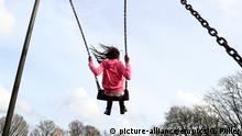 Playground stock. PERMISSION GRANTED. A young girl enjoys playing on swings in a park near Ashford, Kent. Picture date: Saturday March 4, 2017. Photo credit should read: Gareth Fuller/PA Wire URN:30392160  