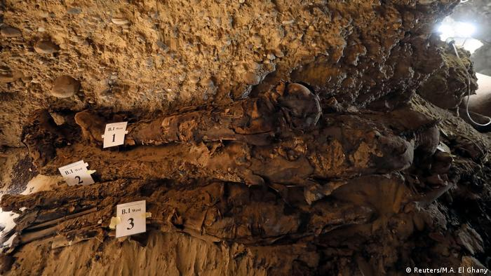 A number of mummies are seen inside the newly discovered burial site in Minya, Egypt (Reuters/M.A. El Ghany)