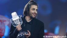 13.05.2017 Portugal's Salvador Sobral celebrates after winning the grand final of the Eurovision Song Contest 2017 at the International Exhibition Centre in Kiev, Ukraine, May 13, 2017. REUTERS/Gleb Garanich TPX IMAGES OF THE DAY