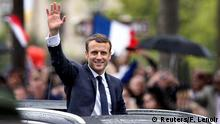 14.05.2017 French President Emmanuel Macron waves from his car on the Champs Elysees avenue after the handover ceremony in Paris, France, May 14, 2017. REUTERS/Francois Lenoir