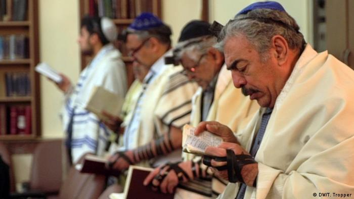 Jewish men during a service at the Sukkot Shalom Synagogue in Tehran