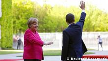 French President Emmanuel Macron waves next to German Chancellor Angela Merkel at a ceremony at the Chancellery in Berlin, Germany, May 15, 2017. REUTERS/Pawel Kopczynski
