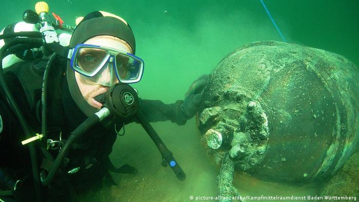 Diver with mine, under water