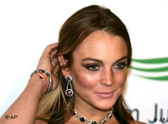 U.S. actress Lindsay Lohan arrives on the red carpet at the Atlantis hotel grand opening on Jumeirah Palm Island in Dubai, United Arab Emirates, Thursday, Nov. 20, 2008. (AP Photo/Kamran Jebreili)