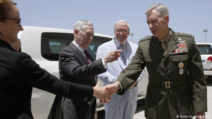 General Thomas D. Waldhauser greets members of a US delegation in Djibouti