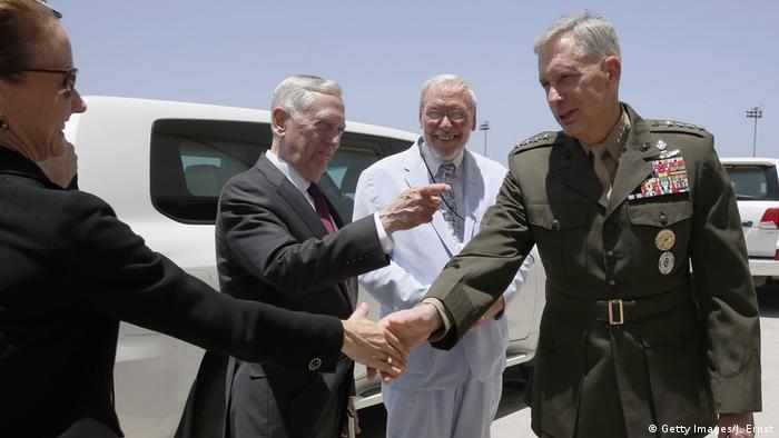 General Thomas D. Waldhauser greets members of a US delegation in Djibouti