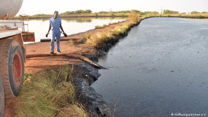 A pond filled with oil in Thar Jath oil field - FILE