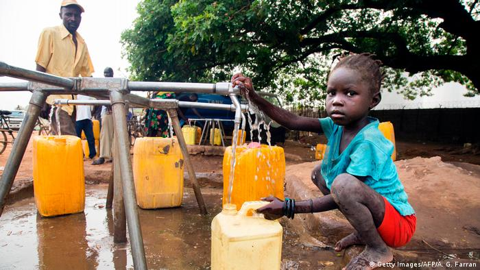 A child collects water from a water point in Juba, South Sudan (Getty Images/AFP/A. G. Farran)