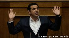 18.05.2017 Greek Prime Minister Alexis Tsipras gestures as he addresses lawmakers before a parliamentary vote on the latest round of austerity Greece has agreed with its lenders, in Athens, Greece, May 18, 2017. REUTERS/Alkis Konstantinidis TPX IMAGES OF THE DAY