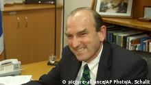 Israeli Foreign Minister Silvan Shalom, left, shakes hand with U.S. Senior Mideast specialist on the National Security Council Elliot Abrams, right, during a meeting in Tel Aviv, Israel Thursday Aug. 5, 2004. Abrams is expected to discuss the plans to expand the Jewish settlement of Maaleh Adumim, linking it with Jerusalem, during a Thursday meeting with Israeli Prime Minister Ariel Sharon. (AP Photo/Ariel Schalit)  