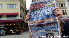 A man reads Sozcu newspaper bearing a headline which translates as Are your conscience confortable ? in Istanbul on April 17, 2017, a day after Turkey's referendum. The deputy leader of Turkey's opposition Republican People's Party (CHP) called on April 17, 2017 for the results of a referendum agreeing new powers for President Recep Tayyip Erdogan to be annulled. / AFP PHOTO / YASIN AKGUL (Photo credit should read YASIN AKGUL/AFP/Getty Images)
