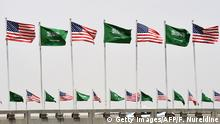 American and Saudi national flags are seen on a main road in Riyadh, on May 19, 2017. Trump, on his first foreign trip since taking office in January, will tell Muslim leaders of his hopes for a peaceful vision of Islam as he seeks support for the war against radical Islamists, Washington has said. / AFP PHOTO / FAYEZ NURELDINE (Photo credit should read FAYEZ NURELDINE/AFP/Getty Images)