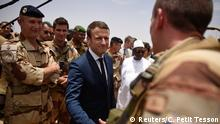 19.5.2017*** French President Emmanuel Macron visits French troops in Africa's Sahel region in Gao, northern Mali, 19 May 2017. REUTERS/Christophe Petit Tesson/Pool