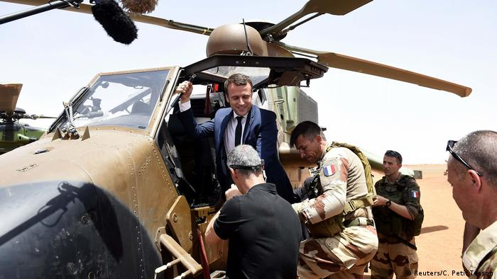 French President Emmanuel Macron arriving per helicopter to visit French troops in northern Mali
