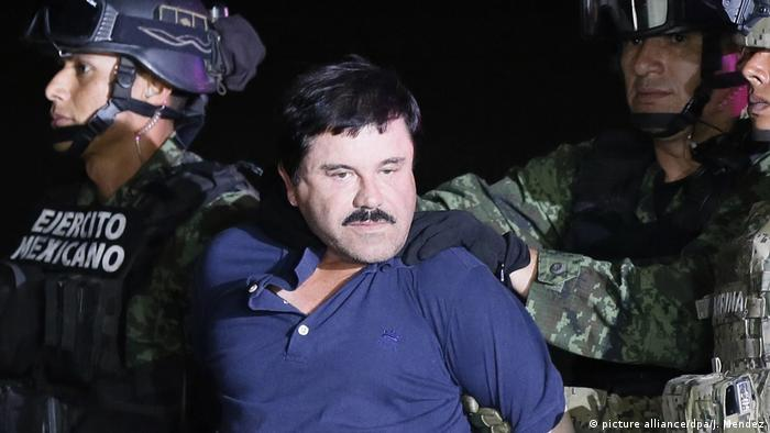In this file photo, Joaquin 'El Chapo' Guzman is escorted by Mexican authorities after being recaptured in October 2016