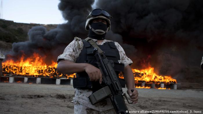 A Mexican military man guards the area where the 134 tons of marihuana are being cremated in a military base in Tijuana