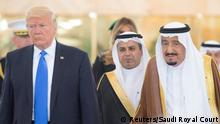 Saudi Arabia's King Salman bin Abdulaziz Al Saud stands next to U.S. President Donald Trump during a reception ceremony in Riyadh, Saudi Arabia, May 20, 2017. Bandar Algaloud/Courtesy of Saudi Royal Court/Handout via REUTERS ATTENTION EDITORS - THIS PICTURE WAS PROVIDED BY A THIRD PARTY. FOR EDITORIAL USE ONLY.