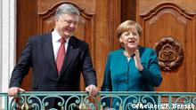 20.5.2017*** German Chancellor Angela Merkel and Ukrainian President Petro Poroshenko attend a meeting at the German government guesthouse Meseberg Palace in Meseberg, Germany, May 20, 2017. REUTERS/Fabrizio Bensch