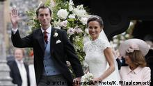 Pippa Middleton and James Matthews smile for the cameras after their wedding at St Mark's Church in Englefield, England Saturday, May 20, 2017. Middleton, the sister of Kate, Duchess of Cambridge married hedge fund manager James Matthews in a ceremony Saturday where her niece and nephew Prince George and Princess Charlotte was in the wedding party, along with sister Kate and princes Harry and William. (AP Photo/Kirsty Wigglesworth, Pool) |