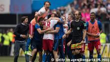 HAMBURG, GERMANY - MAY 20: Team of Hamburg celebrates after the Bundesliga match between Hamburger SV and VfL Wolfsburg at Volksparkstadion on May 20, 2017 in Hamburg, Germany. (Photo by Maja Hitij/Bongarts/Getty Images)