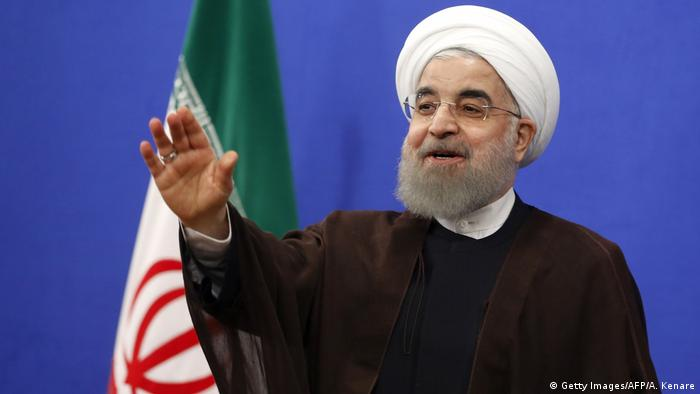 Iranian President Hassan Rouhani gestures during a televised speech