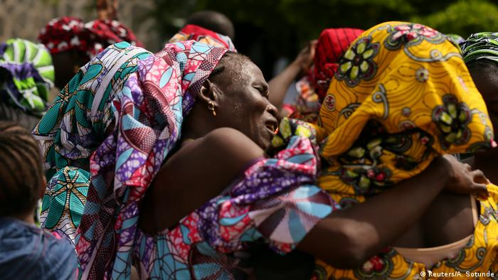 Families meet some of the released Chibok girls in May 2017