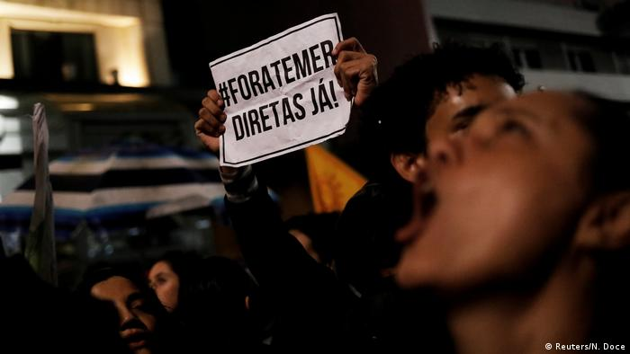 Demonstrators shout slogans during a protest against Brazil's President Michel Temer in Sao Paulo