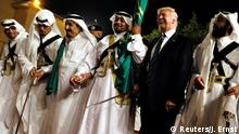 U.S. President Donald Trump dances with a sword as he arrives to a welcome ceremony by Saudi Arabia's King Salman bin Abdulaziz Al Saud at Al Murabba Palace in Riyadh, Saudi Arabia May 20, 2017. REUTERS/Jonathan Ernst TPX IMAGES OF THE DAY