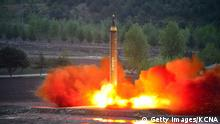 a test launch of the ground-to-ground medium long-range strategic ballistic rocket Hwasong-12 (Getty Images/KCNA)