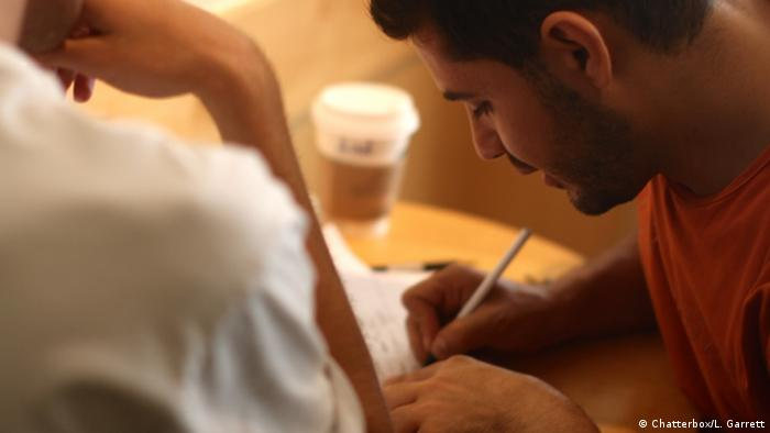 A Syrian dentist tutors a student in Arabic