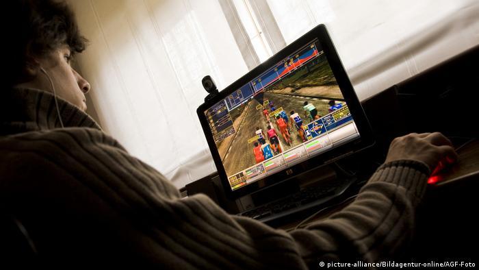 Teenager playing video game