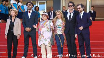 Agnes Varda on the Cannes red carpet with five stars