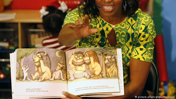 Michelle Obama holding 'Where The Wild Things Are,' Maurice Sendak(picture alliance/dpa/Newscom)