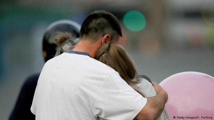 People comforting each other after Manchester terror attack
