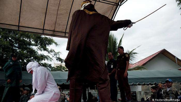 Public caning of a woman in Banda Aceh (Reuters/Beawiharta)